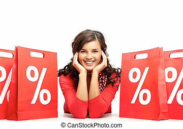 Sales period - Portrait of a young girl among discount paper...