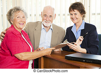 Sales Person and Senior Couple