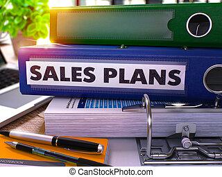 Sales Plans on Blue Ring Binder. Blurred, Toned Image.
