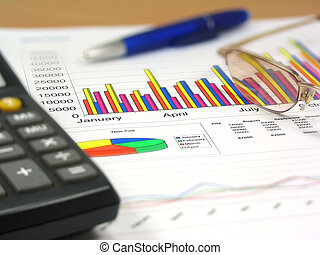 Sales Report 4 - Colorful sales charts, calculator, blue pen...