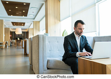 Sales Representative Giving Final Touch For Meeting