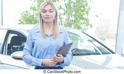 Sales representative is inviting to buy a car.