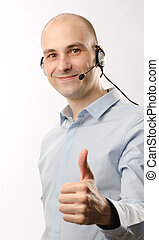 sales representative man with an headset shows his thumb up