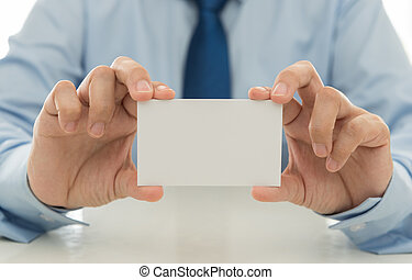 Sales show a business card to introduce itself to customers. free space for text.