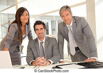 Sales team having business presentation in office