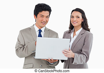 Sales team with their laptop
