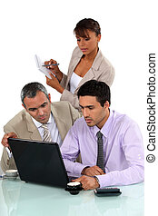 Sales team working on laptop