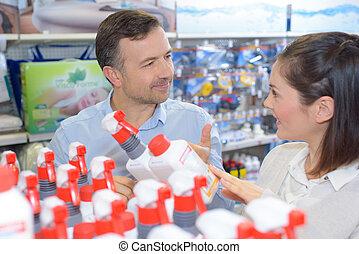 Salesman advising customer in hardware store
