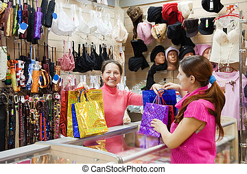 Salesman and buyer  at  counter in shop