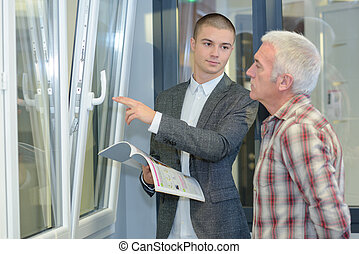 Salesman displaying double glazed windows