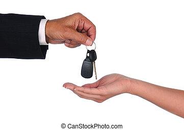 Salesman giving keys to woman - Closeup of a car salesman...