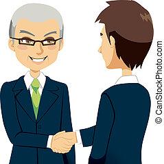 Salesman Handshake - Senior experienced salesman agent...