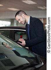 Salesman looking inside the car