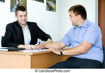 Salesman or real estate agent signing a deal