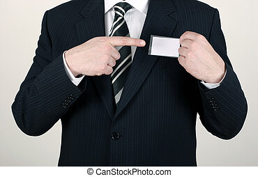 Salesman pointing out his nametag - Business man wearing a...