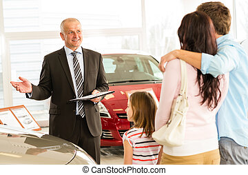 Salesman selling car to family - Salesman selling car to...