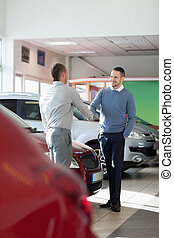 Salesman shaking hand to a customer