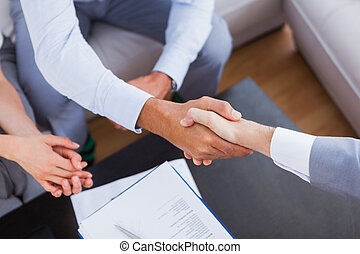Salesman shaking hands with client