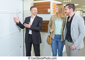 Salesman showing couple building materials