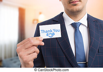 Salesman showing gratitude with business card