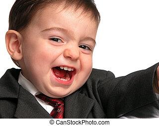 Salesman Smile - Huge close-up smile on a boy wearing a suit...