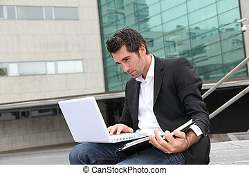 Salesman working outside building of offices