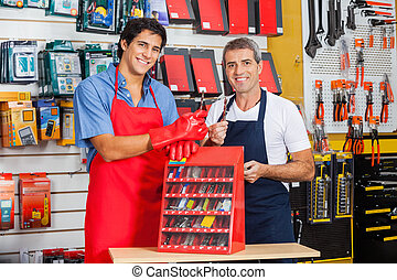 Salesmen Showing Drill Bits In Shop