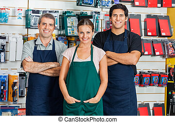 Salespeople Standing In Hardware Store - Portrait of...