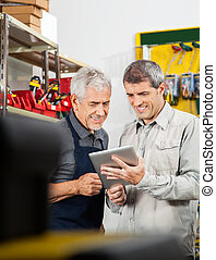 Salesperson And Customer Using Digital Tablet