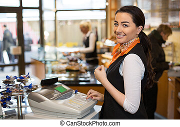 Salesperson at cash register - Saleswoman working at cash ...