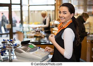 Salesperson at cash register - Saleswoman working at cash...
