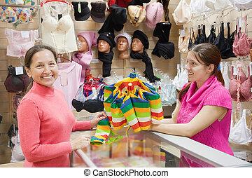 Saleswoman and customer  at  counter