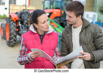 saleswoman convincing young famrer to buy new agricultural machinery