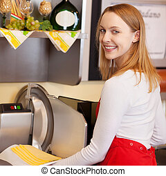Saleswoman Holding Sliced Cheese While Standing Against...