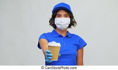 saleswoman in face mask with takeaway coffee cup - health ...