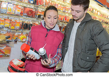 saleswoman talking to client in hardware store