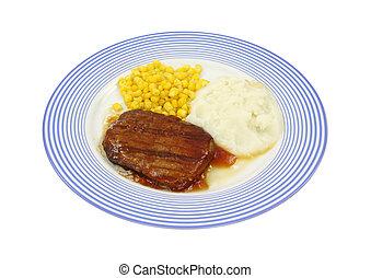 Salisbury steak dinner on blue plate