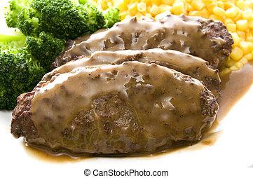 salisbury steak dinner - salisbury steak topped with gravy...