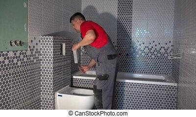 salle bains, embraser, toilette, homme, ouvrier, moderne, habile, installer, nouveau, bouton