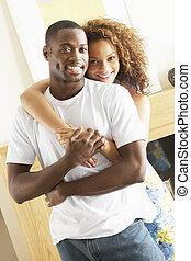 salle de séjour, couple, jeune, embrasser, romantique