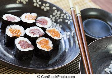 Salmon and Tuna Maki Rolls - Tuna and salmon maki rolls with...