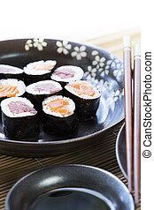 Salmon and Tuna Maki Rolls Vertical