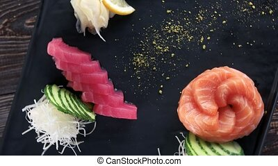 Salmon and tuna sashimi. Fish, ginger and wasabi.