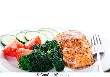 Salmon and Vegetable Dinner with Fork - A dinner of baked...