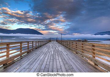 Salmon Arm Wharf on a cloudy morning sunrise.