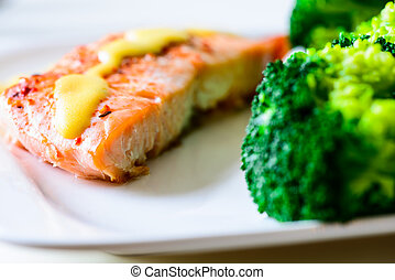 Salmon with Broccoli on white plate