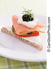 Salmon Canape - Smoked salmon canape on rye bread with cream...