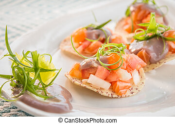 Salmon Ceviche - Salmon ceviche served on taro chips topped...