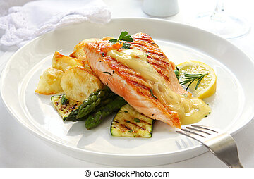 Atlantic salmon grilled to perfection, over potatoes, asparagus and grilled courgette. Topped with hollandaise sauce.