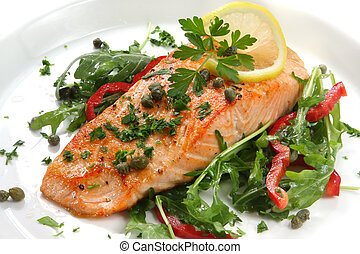 Atlantic salmon with a rocket salad, garnished with lemon, capers and parsley.